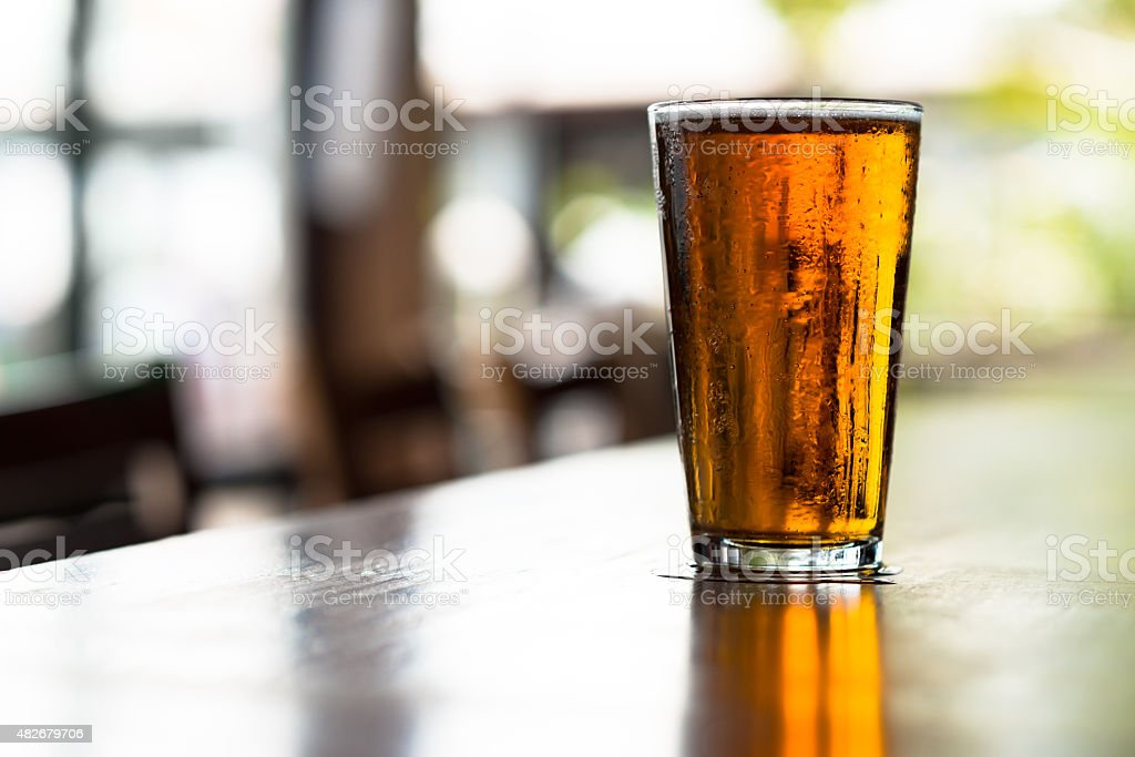 Pint of Ale Beer on Bar stock photo