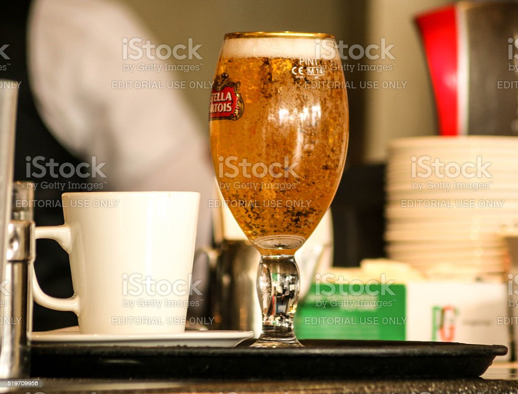 Pint of Beer and a coffee stock photo