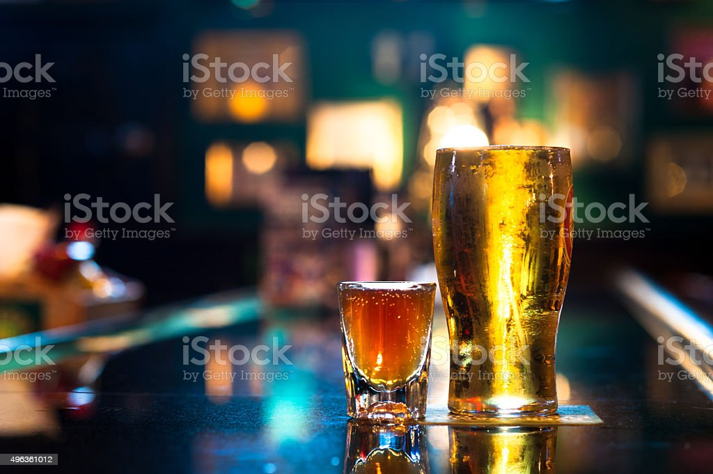 Pint of Beer and Shot of Whiskey on Bar stock photo