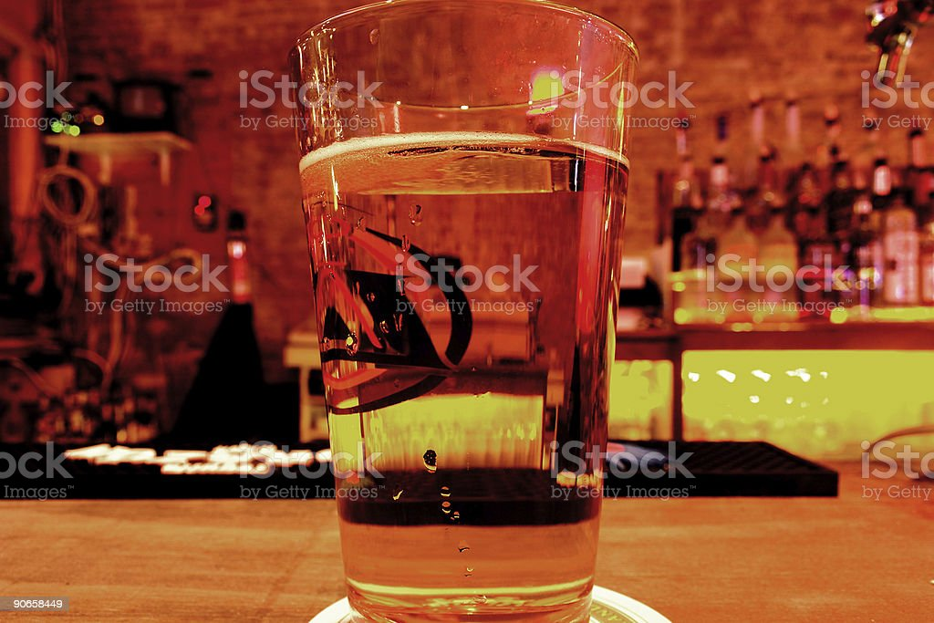 Pint of Beer (Lager) on a Bar Counter - Close-Up royalty-free stock photo