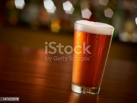 istock Pint of Beer On a Bar 147422578