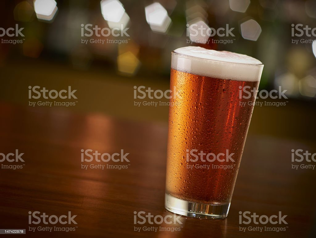 Pint of Beer On a Bar stock photo