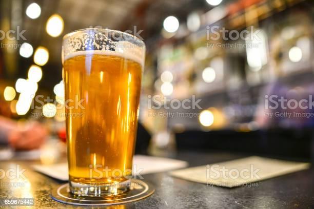 Pint of craft beer on bar with bokeh picture id659675442?b=1&k=6&m=659675442&s=612x612&h=widbki8gkqsbsoynbl1z4f4tklkpi39jk0ys5aikp s=