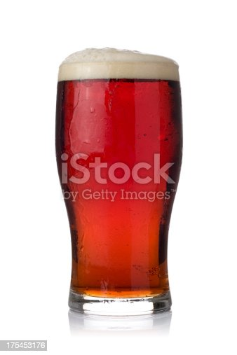 Pint of dark ale in a tulip style pint glass. Isolated on white.