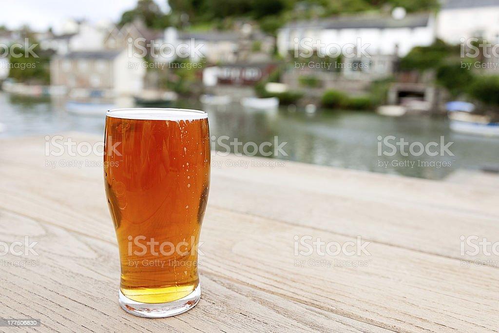 Pint of Real Ale outside a Riverside Village Pub stock photo