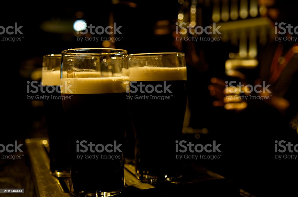Pint of stout beer served in two time stock photo