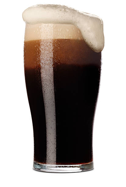 pint of stout - dark beer stock photos and pictures