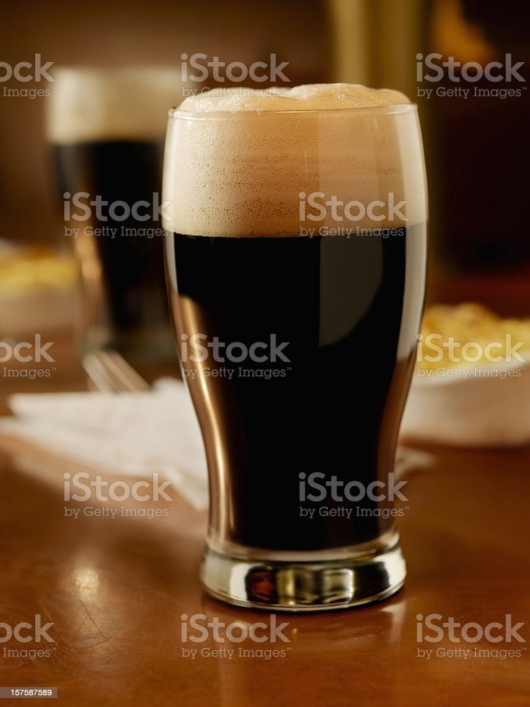 Pint of Stout with shepherds pie stock photo