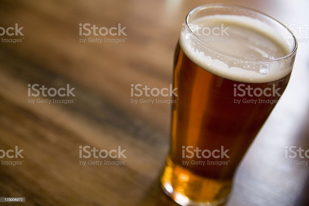 Pint of traditional beer or ale on table royalty-free stock photo