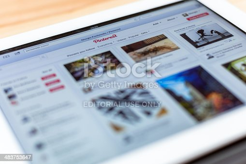 Verona, Italy - April 9, 2012: close-up view of a white third generation iPad (2012) showing the Pinterest website. Pinterest is a social network focused on images.