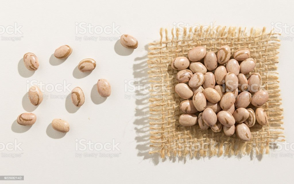 Pinto Bean legume. Close up of grains spreaded over white table. stock photo