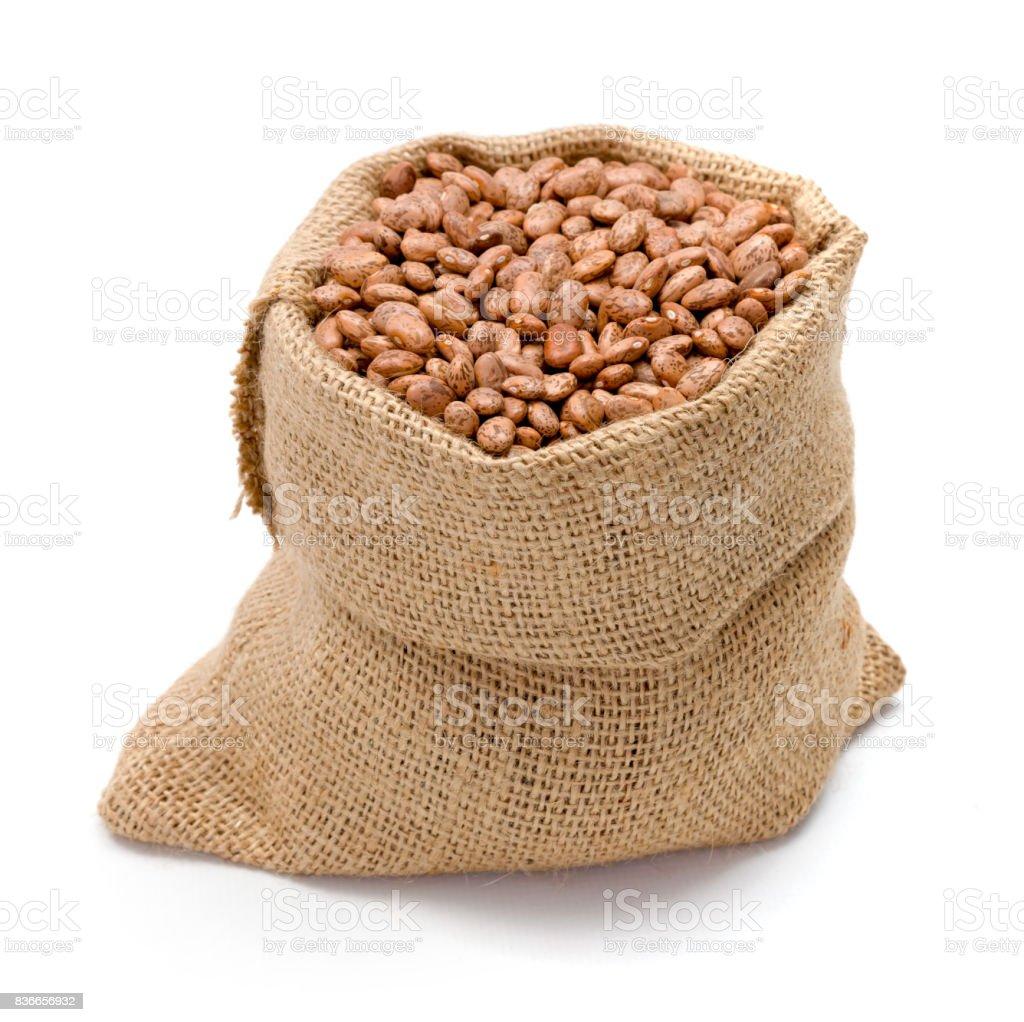 Pinto beans in burlap bag stock photo