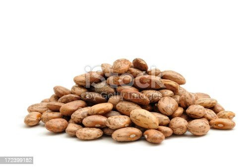 A close up shot of Pinto Beans isolated on a white background.