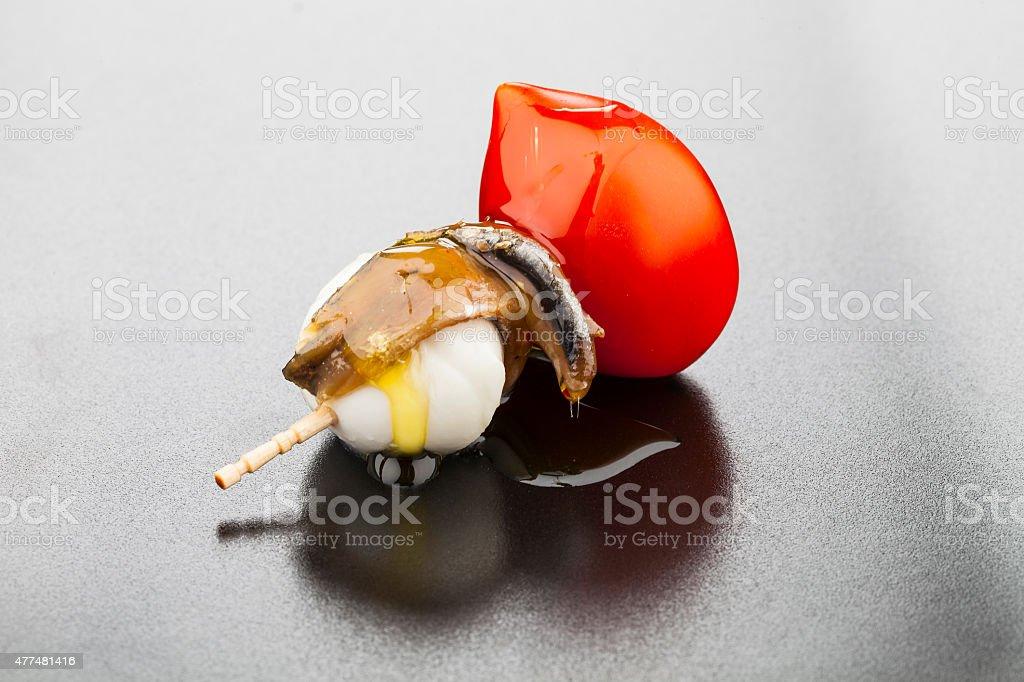 Pintxo de anchoa con tomate y mozzarella stock photo