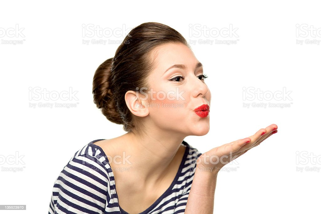 Pin-up girl blowing a kiss stock photo