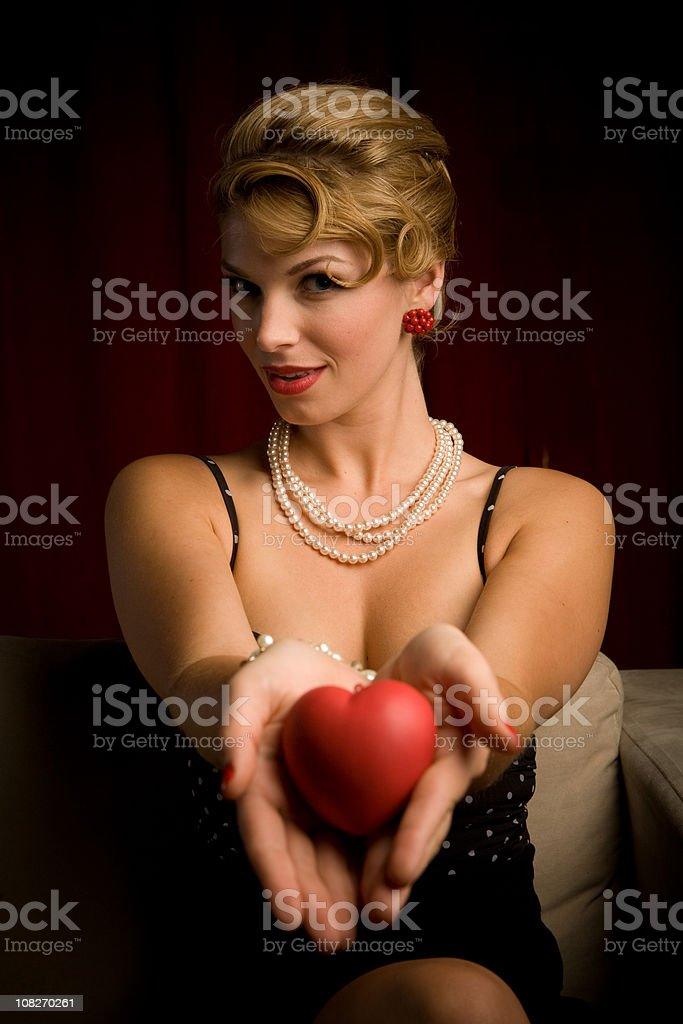 Pinup Girl Offering Her Heart royalty-free stock photo