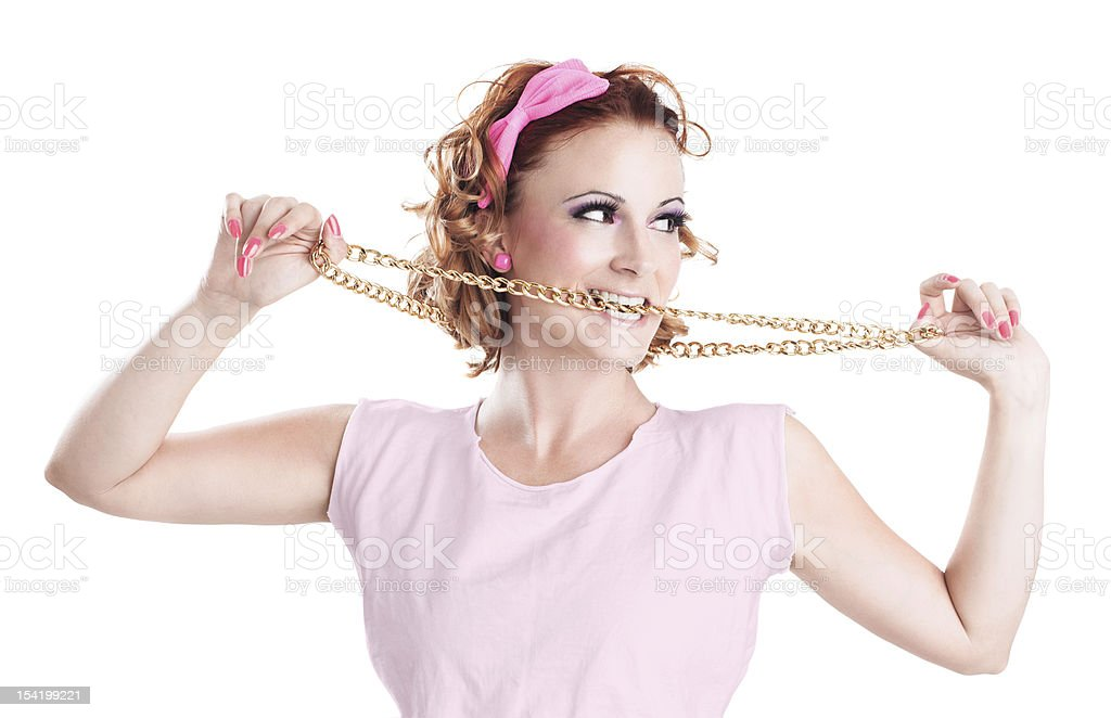 Pin-up girl, retro styling, biting golden chain, copy space stock photo