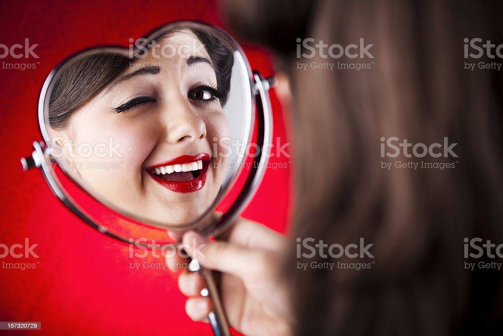 Pin-up girl winking at mirror royalty-free stock photo