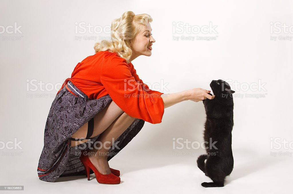 pin-up girl with black cat stock photo