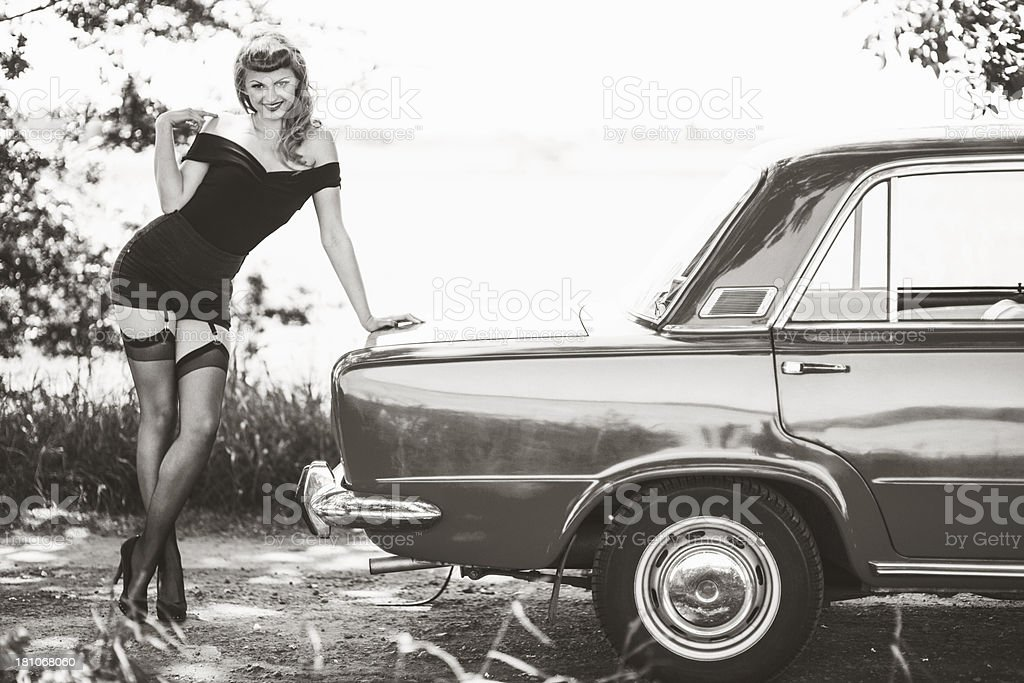 Pin-up girl with car stock photo