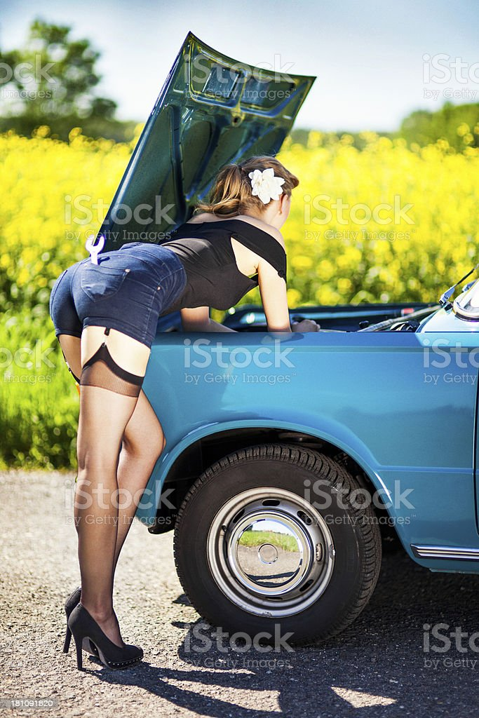 Pin-up girl with car royalty-free stock photo