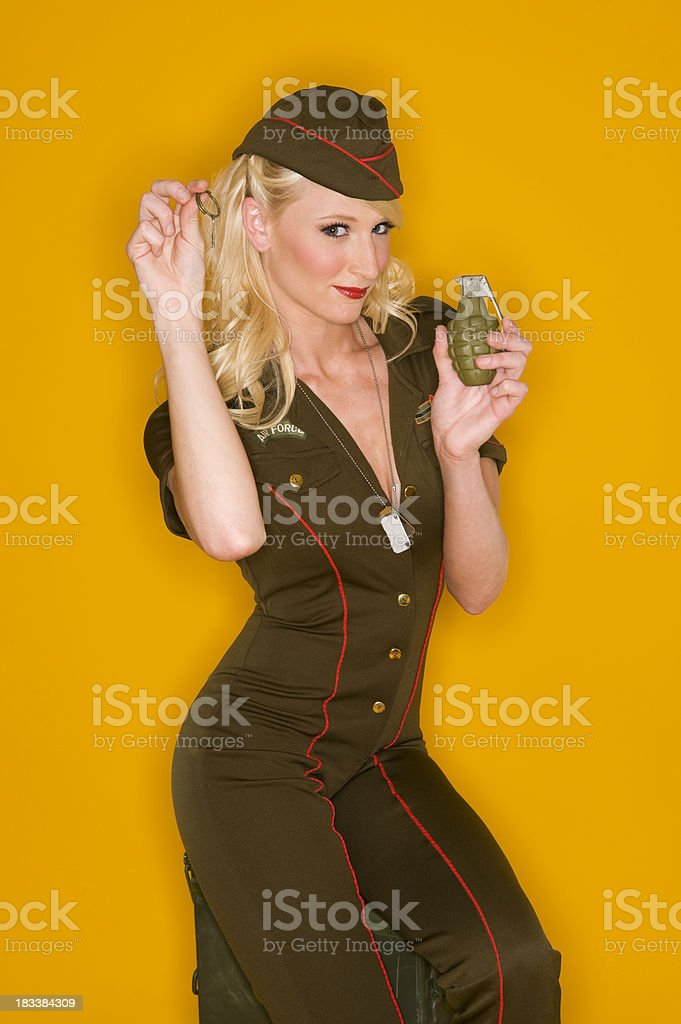 Pinup girl with grenade stock photo