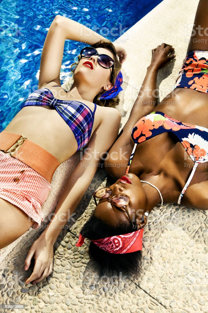 Pin-Up girls at the swimming pool stock photo