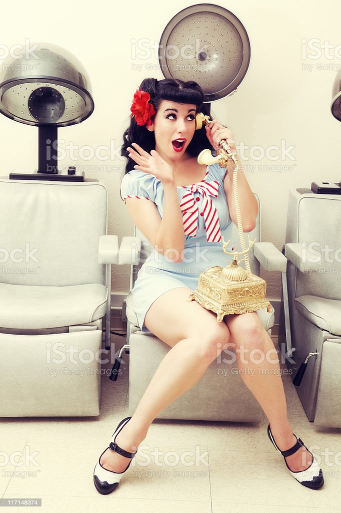 Pinup sexy woman in a beauty salon on the phone stock for 1950 s beauty salon