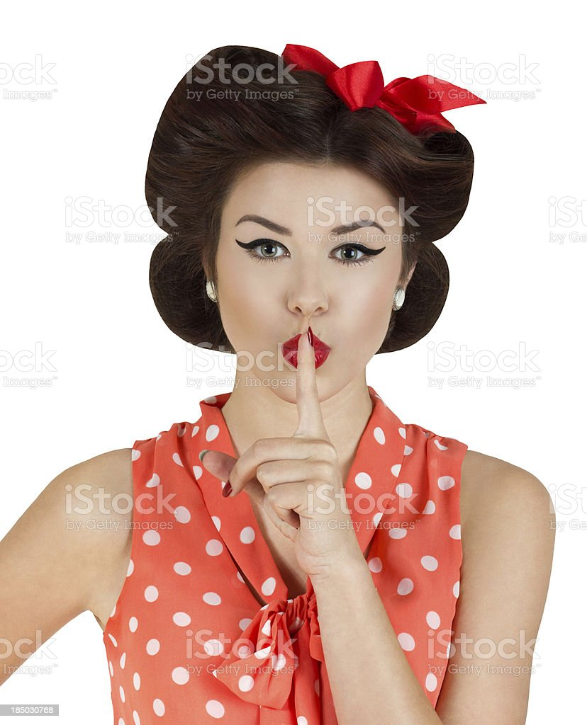 Pin-up style girl with finger on lips stock photo