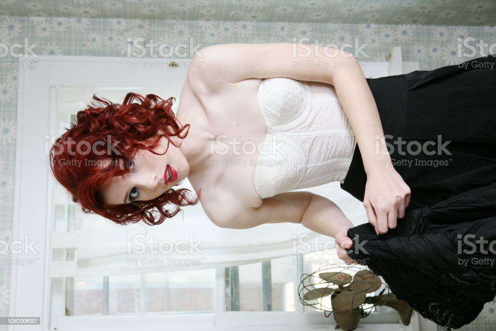 Pin-Up Style Retro Woman Getting Dressed royalty-free stock photo