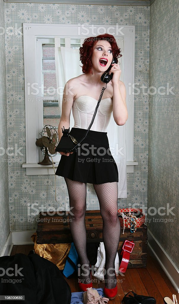 Pin-Up Style Retro Woman Speaking on Vintage Telephone royalty-free stock photo