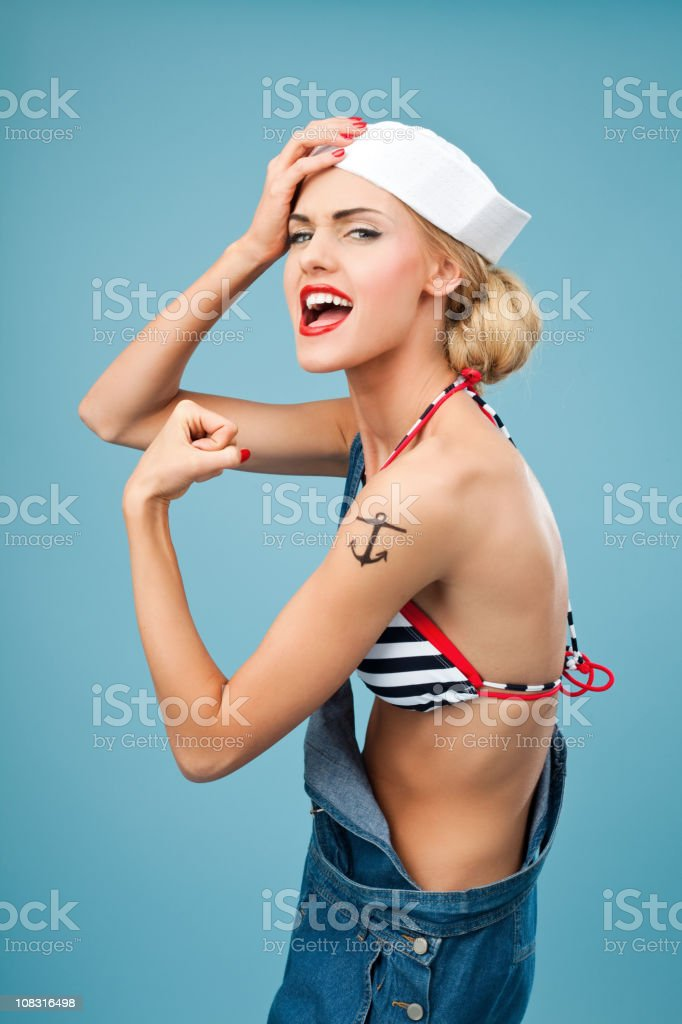 Pin-up style sailor woman flexing her arm  20-24 Years Stock Photo