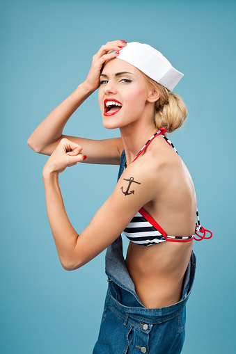 Pinup Style Sailor Woman Flexing Her Arm Stock Photo - Download Image Now