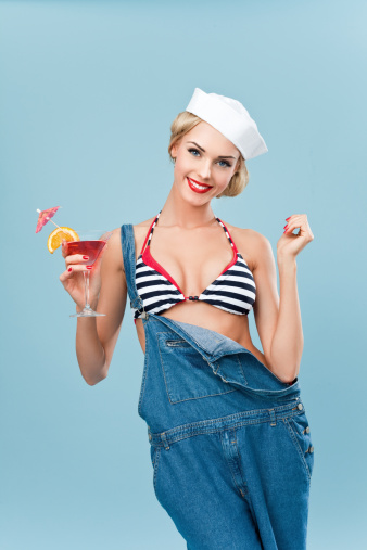 Pinup Style Sailor Woman Holding A Tropical Cocktail Stock Photo - Download Image Now