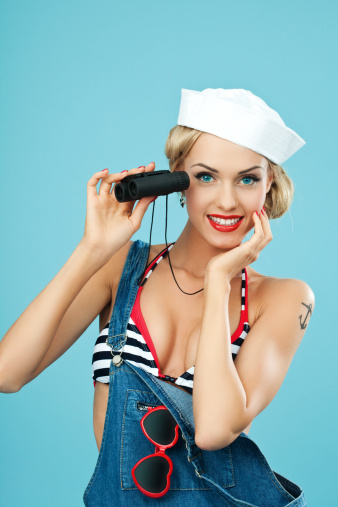 Pinup Style Sailor Woman Holding Binoculars In Hand Stock Photo - Download Image Now