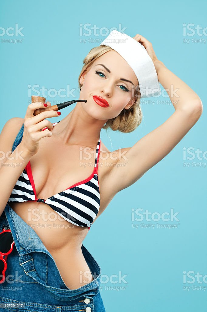Pin-up style sailor woman holding pipe in hand royalty-free stock photo