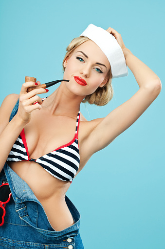Pinup Style Sailor Woman Holding Pipe In Hand Stock Photo - Download Image Now