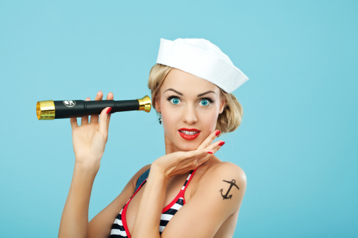 Pinup Style Sailor Woman Holding Telescope Stock Photo - Download Image Now