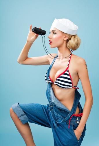 Pinup Style Sailor Woman Looking Through Binoculars Stock Photo - Download Image Now