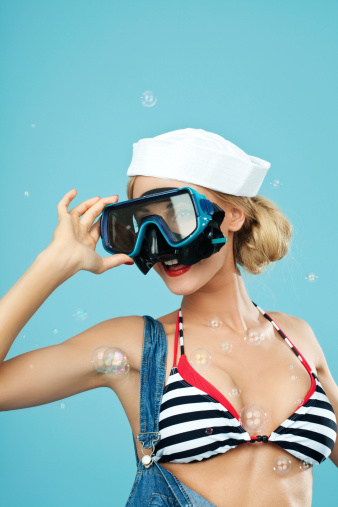 Pinup Style Sailor Woman Looking Through Scuba Mask Stock Photo - Download Image Now