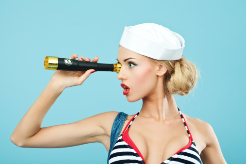 Pinup Style Sailor Woman Looking Through Telescope Stock Photo - Download Image Now