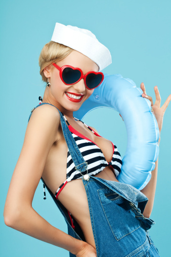 Pinup Style Sailor Woman With Sunglasses And Lifebouy Stock Photo - Download Image Now