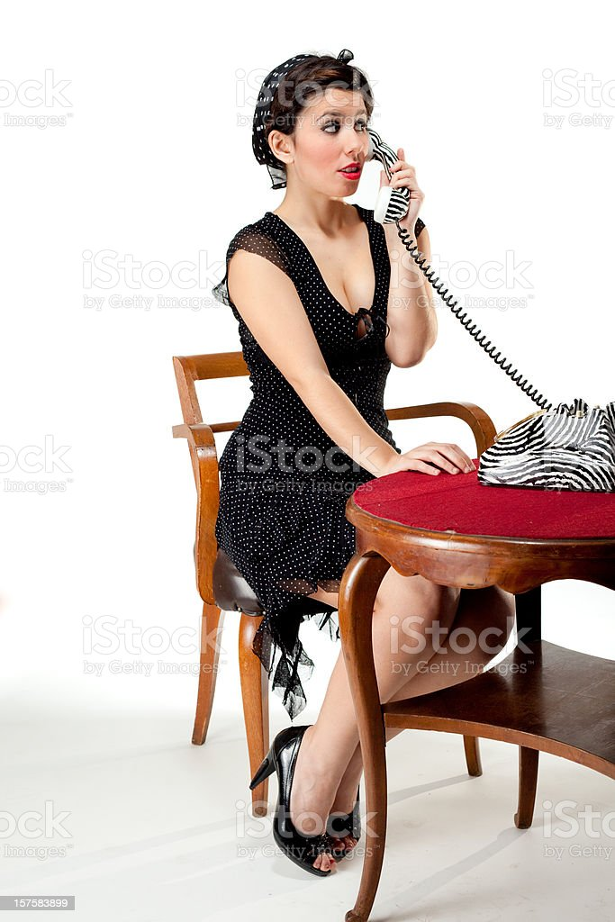 Pin-Up Style Sexy Secretary on the phone royalty-free stock photo