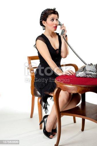 istock Pin-Up Style Sexy Secretary on the phone 157583899