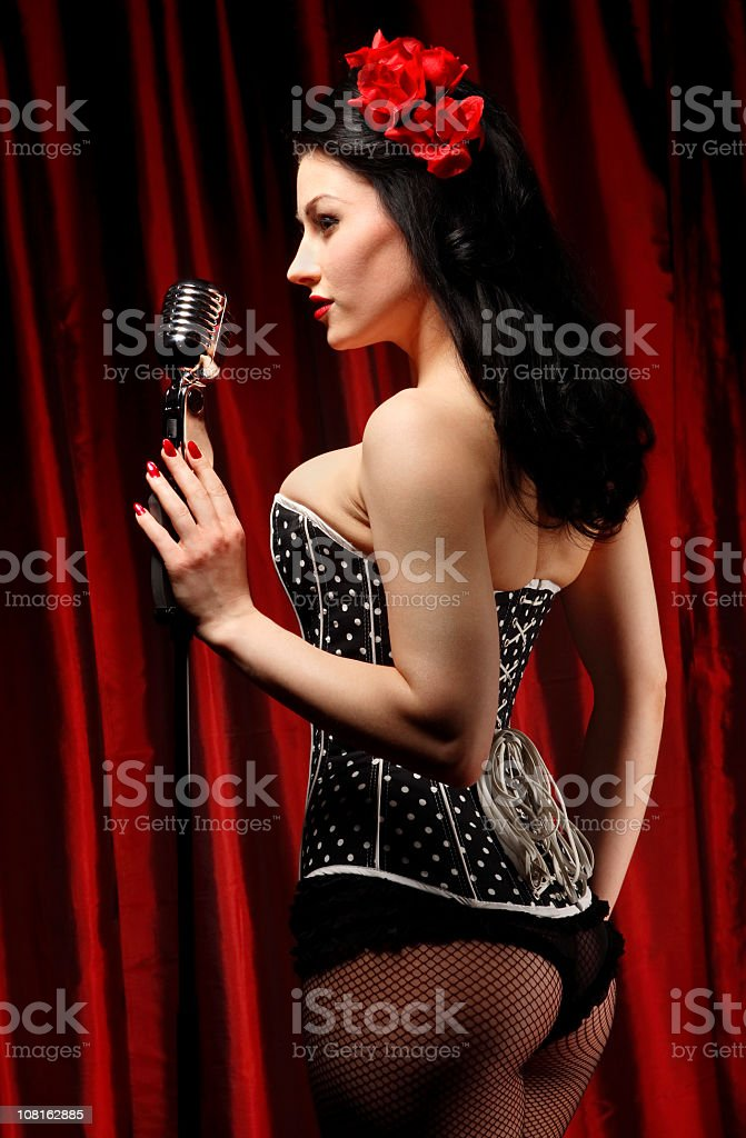 Pin-Up Style Woman Holding Old Microphone royalty-free stock photo