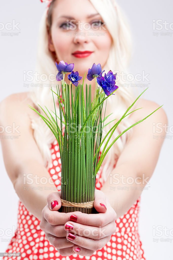 Pinup Woman Holding Bunch of Flowers stock photo