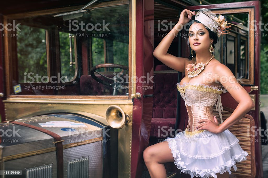 Pin-up woman over retro car stock photo
