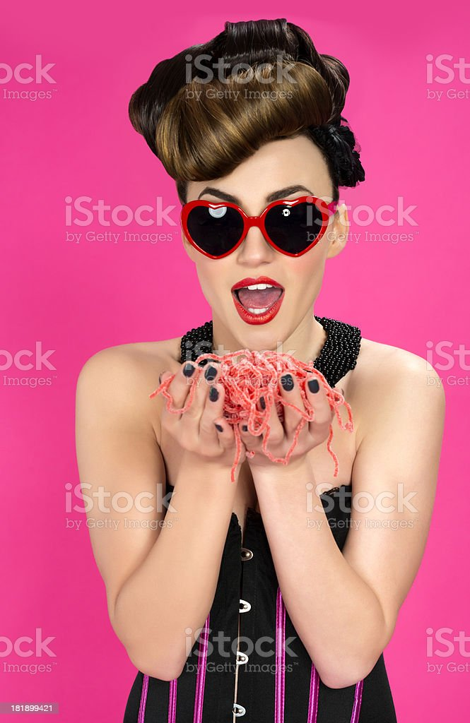 Pinup Woman with Candy Spaghetti royalty-free stock photo