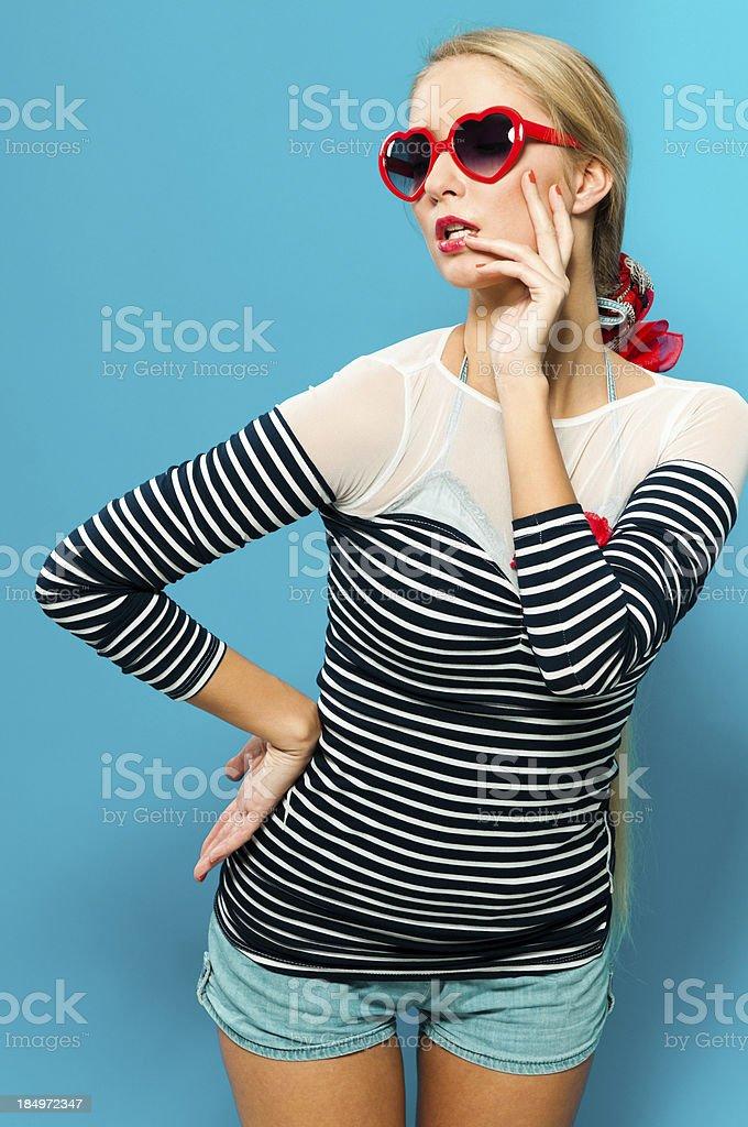 Pin-up woman with sunglasses flirting royalty-free stock photo