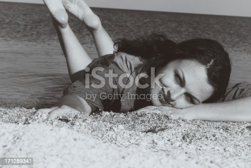 istock Pin-up.On a sand 171289341